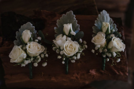 Mini rose and baby's breath buttonholes