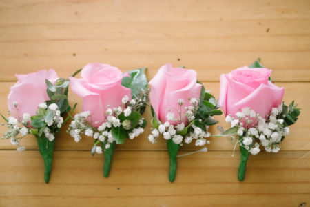 Pink rose and baby's breath buttonholes