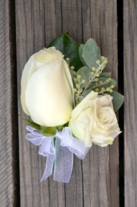 White rose and lisianthus buttonhole