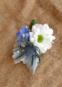 Pastel blue and white buttonhole